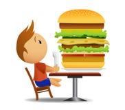 Hombres que van a comer la hamburguesa muy grande Fotografía de archivo libre de regalías