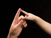 Hombres y dedos del niño en tacto Imagen de archivo libre de regalías