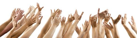 Hombres y las manos de las mujeres para arriba aumentadas Imágenes de archivo libres de regalías