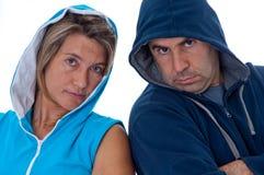 Hombres y mujer en ropa de los deportes Foto de archivo libre de regalías