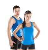 Hombre y mujer atléticos Imagen de archivo