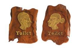 Hombres y mujeres de madera de la muestra del retrete Foto de archivo libre de regalías