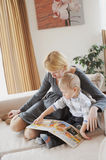 At home. Mother and child reading a book Royalty Free Stock Photo