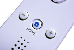Home. Button on a wireless game controller royalty free stock images