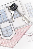 Home. A pair of keys on a house blueprints Royalty Free Stock Photography