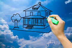 Home. Hand drawing dream home on blue sky Stock Photos