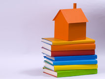 Home. Model on the colored books royalty free stock photography