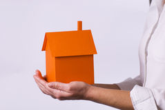 Home. Model on woman's hands royalty free stock image
