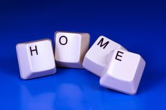 Home. Written with keyboard keys, isolated on blue background Stock Image