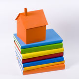 Home. Paper mome model on colors books Royalty Free Stock Photos