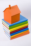 Home. Paper mome model on colors books Stock Image