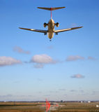 Almost home. Runway stretches out ahead of jet just about to land Royalty Free Stock Photo