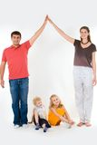 Home. Image of husband and wife touching their hands over children Stock Photos