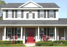 Home. With red door stock photography