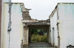 Home abandoned and damaged by the passage of years, old construction of the home of a family royalty free stock image