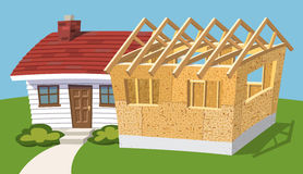 Home addition. Small house with new addition being built Royalty Free Stock Images