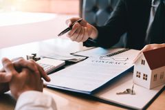 Home agents are sending pens to customers signing a contract to buy a new home.  royalty free stock photo