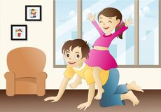 Home alone. Brother-sister duo playing in the living room while they're parents are away Stock Photo