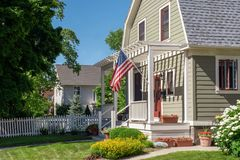 Patriotic home in Wisconsin. Home with american flag on front porch in Kenosha, Wisconsin royalty free stock images