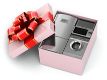Home appliance in gift box with ribbons and bow. Royalty Free Stock Image