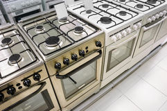 Home appliance  store, row of gas stoves. Rows of gas stoves selling in home appliance store Royalty Free Stock Photo
