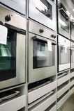 Home appliance  store, row of ovens Stock Photography