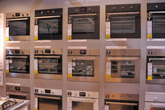 Home appliance store, row of ovens Stock Photo