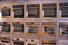 Home appliance store, row of ovens Stock Image