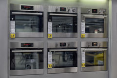 Home appliance store, row of ovens Royalty Free Stock Photo