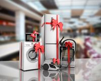 Home appliances as a gift Group of white refrigerator washing ma. Chine stove microwave oven vacuum cleaner with red strip sale background 3d render Stock Photo