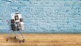 Home appliances in the shopping cart E-commerce or online shoppi Stock Image