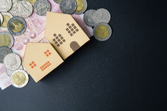 Home architectural model paper box cubes, Banknotes Thailand and Stock Photo