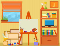 Home art studio with easel and painting tools Stock Photography