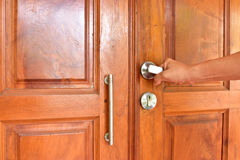 Home. Asian men open the door wood for leave the house Stock Photos