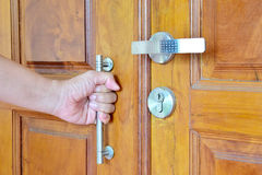 Home. Asian men open the door wood for leave the house Stock Photography