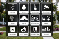 Home automation icons to control a smart home like light, water, surveillance, energy, smoke detection, motion sensors. Using flat design with blurred photo of royalty free stock photography
