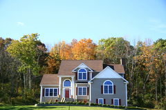 Home in the autumn. Home in New York in the autumn,surrounded by many multicolored Royalty Free Stock Image
