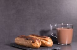 Homemade eclair on a stone table royalty free stock photos
