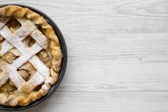 Home-baked apple pie on white wooden background, top view. Flat lay, overhead, from above. Space for text.  stock images