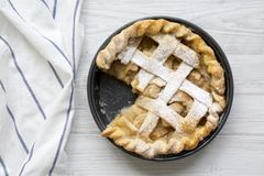 Home-baked apple pie on white wooden surface, top view. Flat lay, overhead, from above. Closeup.  royalty free stock photo