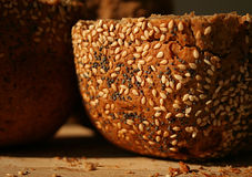 Home-baked bread. Crispy home-baked bread with sesame and poppy seeds Stock Image