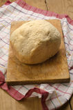 Home baked bread on wooden board Royalty Free Stock Image