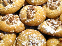 Home-baked Christmas cookies. With walnut and powdered sugar Royalty Free Stock Photo