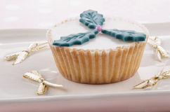 Home baked cupcake with christmas holly Royalty Free Stock Images