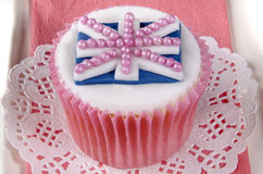 Home baked cupcake with union jack. Home baked cupcake with white icing and union jack Royalty Free Stock Photography