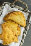 Home Baked Empanadas Turnover Pies with Pisto Vegetable Cheese Filling in Tomato Sauce in Wicker Basket on White Linen Napkin Stock Photos