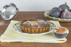 Home baked fig and almond tart. With fresh figs on the side Stock Images