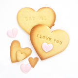 Home baked heart cookies with letterpress words. Of I Love You and Eat Me Royalty Free Stock Photography