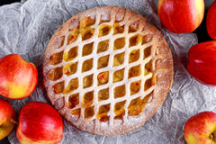 Home baked Lattice apple pie on crumpled paper Stock Photography