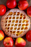 Home baked Lattice apple pie on wooden table Royalty Free Stock Photo